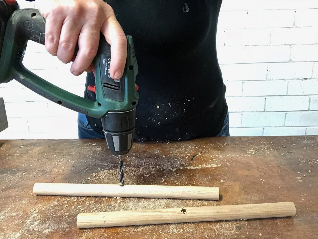 drilling holes for the legs of an indoor planter