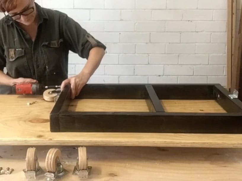 How to attach the wheels to the table frame