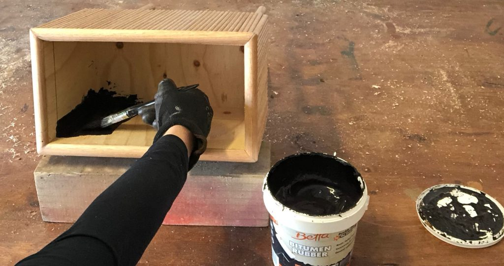 Use a brush to apply Gripset Betta Bitumen Rubber (found in Bunnings) inside the box to about 70mm from the top, leaving to dry thoroughly between coats.